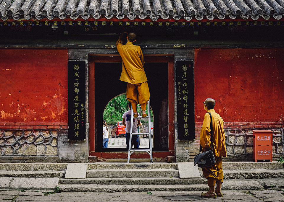 Two Buddhist monks repairing a temple.